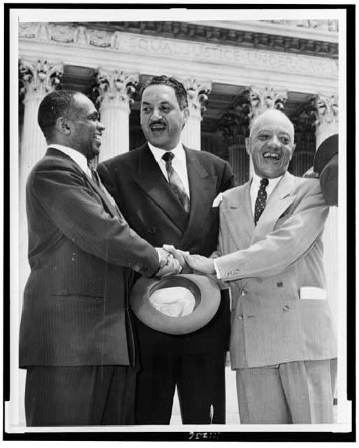 Brown Attorneys After the Decision: George E. C. Hayes, Thurgood Marshall, and James M. Nabrit congratulating each other, 1954
