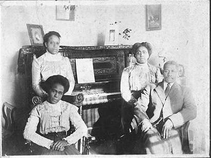 African Americans in Front of Piano