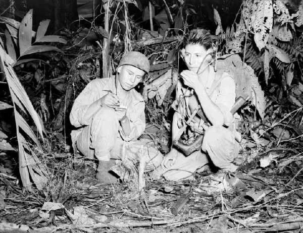 Cpl. Henry Bake, Jr and Pfc. George H. Kirk Operating a Portable Radio Set