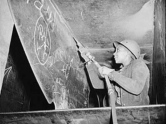 Miss Eastine Cowner, A Former Waitress, Is Helping In Her Job As A Scaler To Construct The Liberty Ship Ss George Washington CarverKaiser Shipyards, Richmond, California