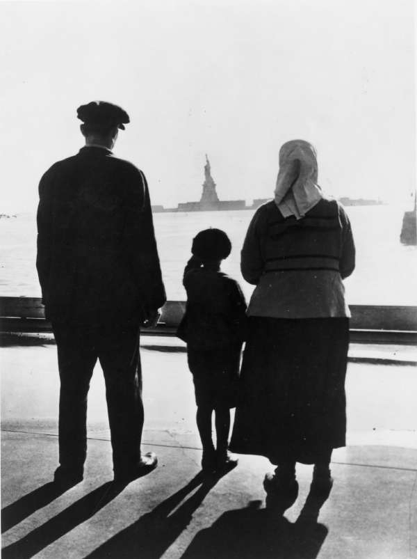 Immigrant Family Looking at The Statue of Liberty