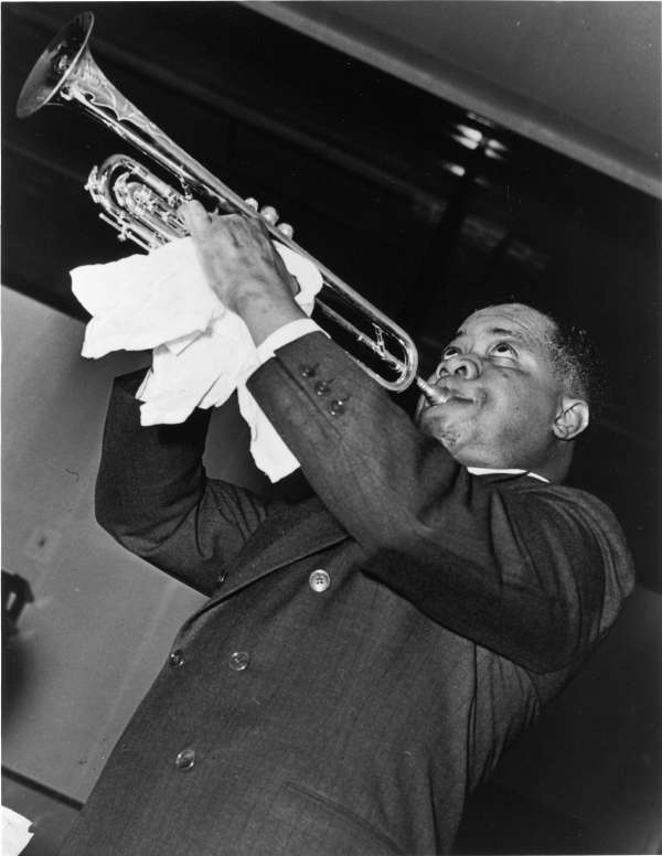 Louis Armstrong, Half-Length Portrait, Facing Left, Playing Trumpet