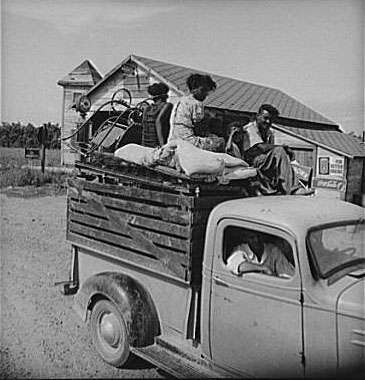 Negro laborer's family being moved from Arkansas to Mississippi by white tenant