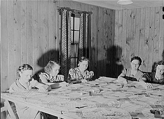 Members of the Women's Club Making A Quilt. Granger Homesteads, Iowa