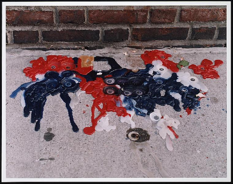 Melted red, white, and blue candle wax on a sidewalk, following the September 11th terrorist attack on the World Trade Center, New York City